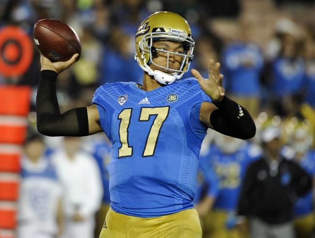 Oct 12, 2013; Pasadena, CA, USA; UCLA Bruins quarterback Brett Hundley (17) throws a pass during the fourth quarter against the California Golden Bears during the Bruins 37-10 win at Rose Bowl.  Mandatory Credit: Robert Hanashiro-USA TODAY Sports