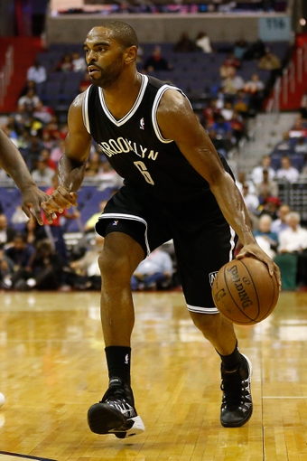 Oct 8, 2013; Washington, DC, USA; Brooklyn Nets shooting guard Alan Anderson (6) dribbles the ball against the Washington Wizards at Verizon Center. Mandatory Credit: Geoff Burke-USA TODAY Sports