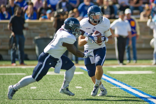 Oct 5, 2013; Tulsa, OK, USA; Rice Owls quarterback Taylor McHargue (16) looks to hand off to running back Jawon Davis (3) during a game against the Tulsa Hurricanes at Skelly Field at H.A. Chapman Stadium. Rice defeated Tulsa 30-27 in an overtime. Mandatory Credit: Beth Hall-USA TODAY Sports