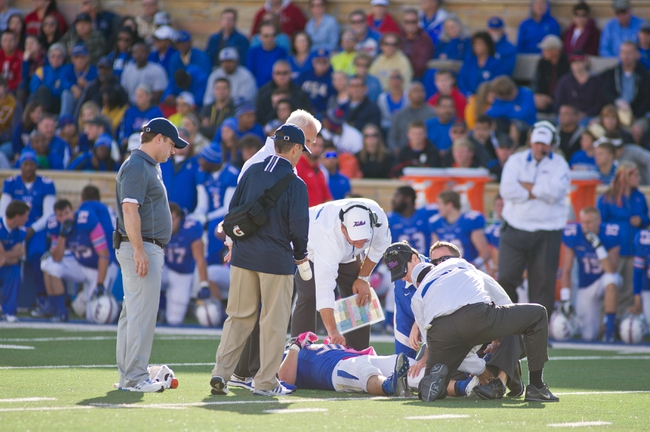 Oct 5, 2013; Tulsa, OK, USA; Tulsa Hurricanes  tight end Garrett McGrady (90) is taken off the field by ambulance following an injury during the second half of a game against the Rice Owls at Skelly Field at H.A. Chapman Stadium. Rice defeated Tulsa 30-27 in an overtime. Mandatory Credit: Beth Hall-USA TODAY Sports
