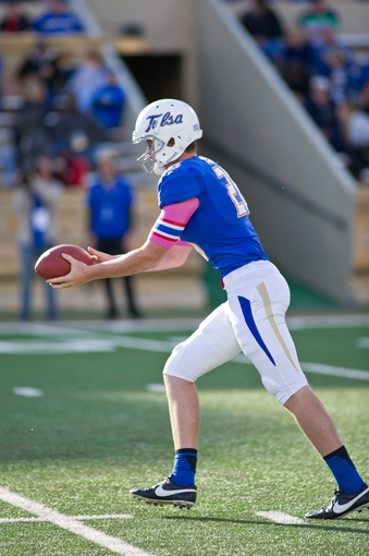 Oct 5, 2013; Tulsa, OK, USA; Tulsa Hurricanes punter Dalton Parks (26) prepares to kick during a game against the Rice Owls at Skelly Field at H.A. Chapman Stadium. Rice defeated Tulsa 30-27 in an overtime. Mandatory Credit: Beth Hall-USA TODAY Sports