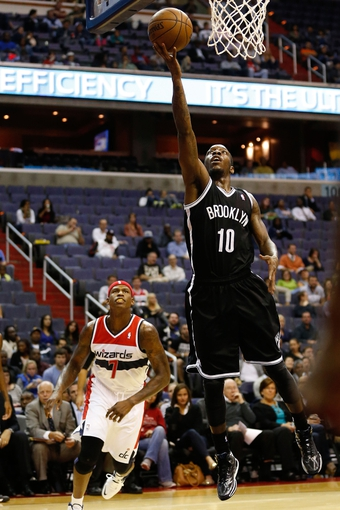 Oct 8, 2013; Washington, DC, USA; Brooklyn Nets point guard Tyshawn Taylor (10) shoots the ball against the Washington Wizards at Verizon Center. Mandatory Credit: Geoff Burke-USA TODAY Sports