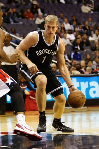 Oct 8, 2013; Washington, DC, USA; Brooklyn Nets power forward Mason Plumlee (1) dribbles the ball against the Washington Wizards at Verizon Center. Mandatory Credit: Geoff Burke-USA TODAY Sports