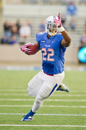 Oct 5, 2013; Tulsa, OK, USA; Tulsa Hurricanes running back Trey Watts (22) carries the ball during a game against the Rice Owls at Skelly Field at H.A. Chapman Stadium. Rice defeated Tulsa 30-27 in an overtime. Mandatory Credit: Beth Hall-USA TODAY Sports