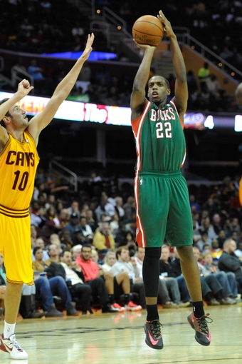 Oct 8, 2013; Milwaukee Bucks small forward Khris Middleton (22) during a game against the Cleveland Cavaliers at Quicken Loans Arena. Cleveland won 99-87. Mandatory Credit: David Richard-USA TODAY Sports