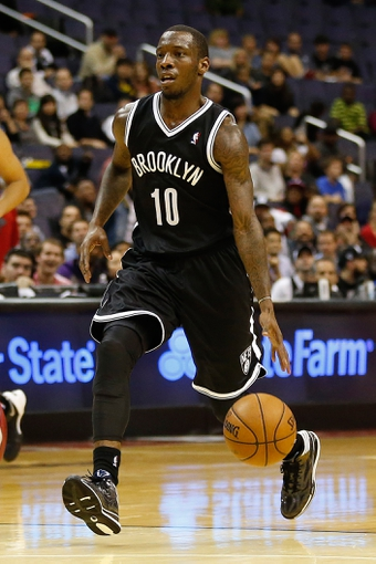 Oct 8, 2013; Washington, DC, USA; Brooklyn Nets point guard Tyshawn Taylor (10) dribbles the ball against the Washington Wizards at Verizon Center. Mandatory Credit: Geoff Burke-USA TODAY Sports