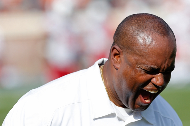 Oct 5, 2013; Charlottesville, VA, USA; Virginia Cavaliers head coach Mike London yells on the sidelines against the Ball State Cardinals at Scott Stadium. Mandatory Credit: Geoff Burke-USA TODAY Sports