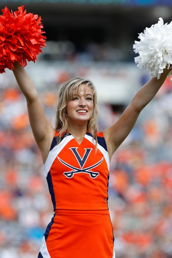 Oct 5, 2013; Charlottesville, VA, USA; A Virginia Cavaliers cheerleader cheer on the field against the Ball State Cardinals at Scott Stadium. Mandatory Credit: Geoff Burke-USA TODAY Sports