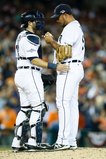 Oct 8, 2013; Detroit, MI, USA; Detroit Tigers catcher Alex Avila (13) talks to relief pitcher Joaquin Benoit (53) during the ninth inning against the Oakland Athletics in game four of the American League divisional series at Comerica Park. Mandatory Credit: Rick Osentoski-USA TODAY Sports