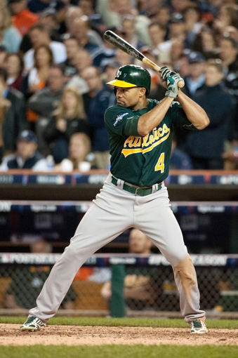 Oct 8, 2013; Detroit, MI, USA; Oakland Athletics center fielder Coco Crisp (4) bats in game four of the American League divisional series against the Detroit Tigers at Comerica Park. Mandatory Credit: Tim Fuller-USA TODAY Sports