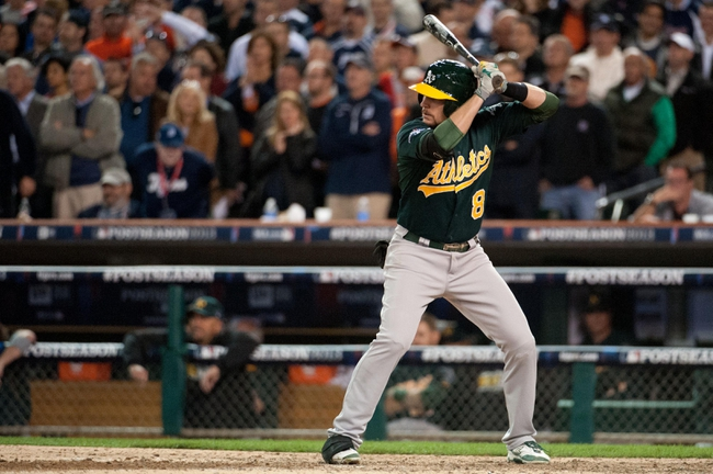 Oct 8, 2013; Detroit, MI, USA; Oakland Athletics shortstop Jed Lowrie (8) bats in game four of the American League divisional series against the Detroit Tigers at Comerica Park. Mandatory Credit: Tim Fuller-USA TODAY Sports