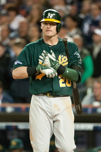 Oct 8, 2013; Detroit, MI, USA; Oakland Athletics third baseman Josh Donaldson (20) in game four of the American League divisional series against the Detroit Tigers at Comerica Park. Mandatory Credit: Tim Fuller-USA TODAY Sports