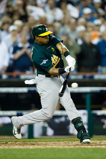 Oct 8, 2013; Detroit, MI, USA; Oakland Athletics left fielder Yoenis Cespedes (52) at bat during the ninth inning against the Detroit Tigers in game four of the American League divisional series at Comerica Park. Mandatory Credit: Rick Osentoski-USA TODAY Sports