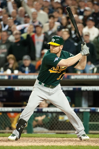Oct 8, 2013; Detroit, MI, USA; Oakland Athletics first baseman Brandon Moss (37) bats in game four of the American League divisional series against the Detroit Tigers at Comerica Park. Mandatory Credit: Tim Fuller-USA TODAY Sports