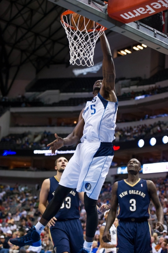 Oct 7, 2013; Dallas, TX, USA; Dallas Mavericks center Bernard James (5) dunks the ball in front of New Orleans Pelicans power forward Ryan Anderson (33) and shooting guard Anthony Morrow (3) during the game at the American Airlines Center. The Pelicans defeated the Mavericks 94-92. Mandatory Credit: Jerome Miron-USA TODAY Sports