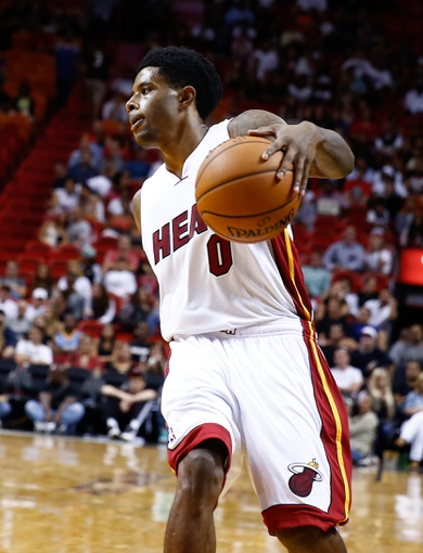 Oct 7, 2013; Miami, FL, USA; Miami Heat guard Larry Drew II (0) dribbles the ball in the second half of a game against the Atlanta Hawks at American Airlines Arena. Mandatory Credit: Robert Mayer-USA TODAY Sports