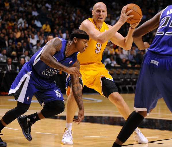 Oct 10, 2013; Las Vegas, NV, USA; Los Angeles Lakers center Chris Kaman (9) keeps the ball away from Sacramento Kings guard Isaiah Thomas (22) during an NBA preseason game at MGM Grand Arena. The Kings won the game 104-86. Mandatory Credit: Stephen R. Sylvanie-USA TODAY Sports