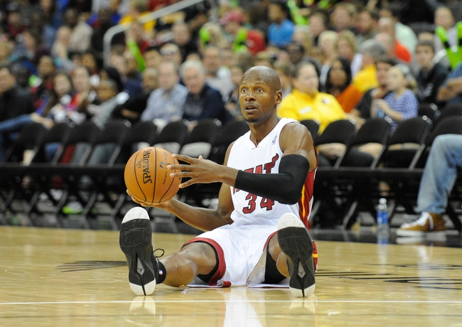 Oct 11, 2013; Kansas City, MO, USA; Miami Heat shooting guard Ray Allen (34) passes the ball against the Charlotte Bobcats in the second half at Sprint Center. Miami won 86-75. Mandatory Credit: John Rieger-USA TODAY Sports