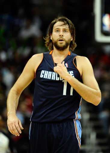 Oct 11, 2013; Kansas City, MO, USA; Charlotte Bobcats power forward Josh McRoberts (11) against the Miami Heat in the second half at Sprint Center. Miami won 86-75. Mandatory Credit: John Rieger-USA TODAY Sports