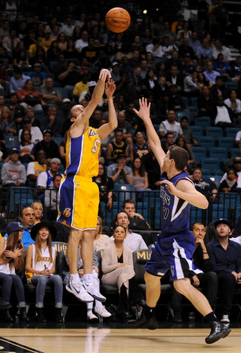 Oct 10, 2013; Las Vegas, NV, USA; Los Angeles Lakers guard Steve Blake (5) makes a 3-point attempt against defending Sacramento Kings guard Jimmer Fredette (7) during an NBA preseason game at MGM Grand Arena. The Kings won the game 104-86. Mandatory Credit: Stephen R. Sylvanie-USA TODAY Sports