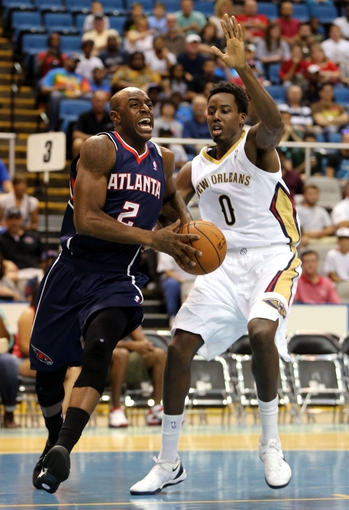 Oct 13, 2013; Biloxi, MS, USA; Atlanta Hawks shooting guard Damien Wilkins (2) drives past New Orleans Pelicans small forward Al-Farouq Aminu (0) during the first half of their game at the Mississippi Coast Coliseum. Mandatory Credit: Chuck Cook-USA TODAY Sports