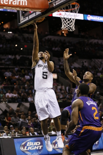 Oct 13, 2013; San Antonio, TX, USA; San Antonio Spurs guard Cory Joseph (5) shoots during the first half against the Phoenix Suns at AT&T Center. Mandatory Credit: Soobum Im-USA TODAY Sports
