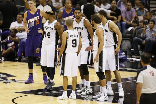 Oct 13, 2013; San Antonio, TX, USA; San Antonio Spurs guard Tony Parker (9) talks to his team during a time out against the Phoenix Suns at AT&T Center. Mandatory Credit: Soobum Im-USA TODAY Sports
