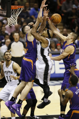 Oct 13, 2013; San Antonio, TX, USA; San Antonio Spurs forward Corey Maggette (14) has his shot blocked by Phoenix Suns center Alex Len (behind) during the first half at AT&T Center. Mandatory Credit: Soobum Im-USA TODAY Sports