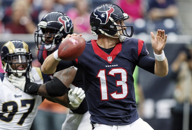 Oct 13, 2013; Houston, TX, USA; Houston Texans quarterback T.J. Yates (13) attempts a pass during the fourth quarter  against the St. Louis Rams at Reliant Stadium. Mandatory Credit: Troy Taormina-USA TODAY Sports