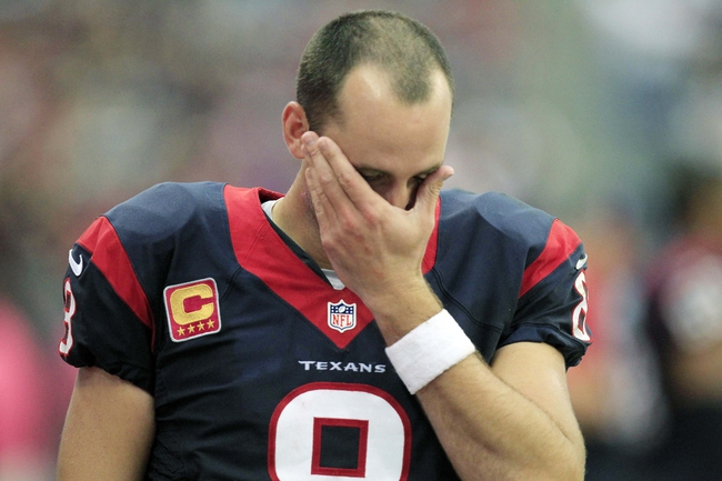 Oct 13, 2013; Houston, TX, USA; Houston Texans quarterback Matt Schaub (8) wipes his face and reacts during the second half of a game against the St. Louis Rams at Reliant Stadium. The Rams won 38-13. Mandatory Credit: Thomas Campbell-USA TODAY Sports