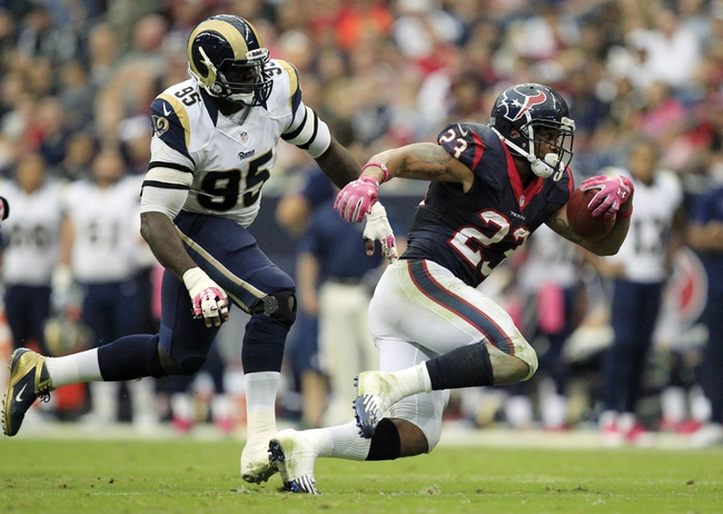 Oct 13, 2013; Houston, TX, USA; Houston Texans running back Arian Foster (23) rushes past St. Louis Rams defensive end William Hayes (95) during the second half at Reliant Stadium. The Rams won 38-13. Mandatory Credit: Thomas Campbell-USA TODAY Sports
