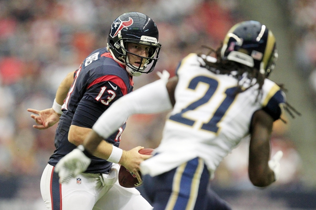 Oct 13, 2013; Houston, TX, USA; Houston Texans quarterback T.J. Yates (13) scrambles against St. Louis Rams cornerback Janoris Jenkins (21) during the second half at Reliant Stadium. The Rams won 38-13. Mandatory Credit: Thomas Campbell-USA TODAY Sports