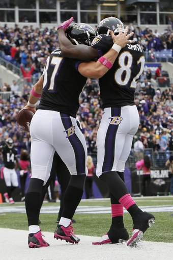 Oct 13, 2013; Baltimore, MD, USA; Baltimore Ravens tight end Dallas Clark (87) celebrates his fourth quarter touchdown catch with wide receiver Torrey Smith (82) against the Green Bay Packers at M&T Bank Stadium. Mandatory Credit: Mitch Stringer-USA TODAY Sports