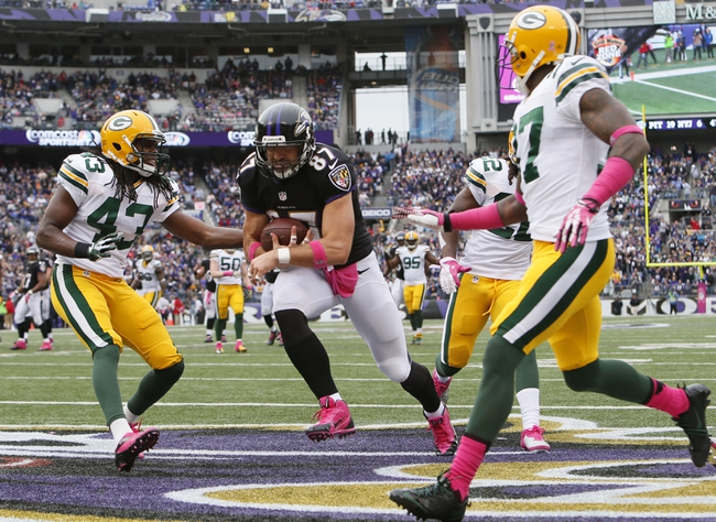 Oct 13, 2013; Baltimore, MD, USA; Baltimore Ravens tight end Dallas Clark (87) runs for a fourth quarter touchdown after catching a Joe Flacco pass (not shown) against the Green Bay Packers at M&T Bank Stadium. Mandatory Credit: Mitch Stringer-USA TODAY Sports