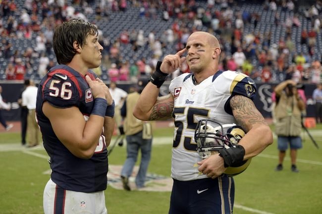 Oct 13, 2013; Houston, TX, USA; St. Louis Rams middle linebacker James Laurinaitis (55) talks to Houston Texans inside linebacker Brian Cushing (56) after the game at Reliant Stadium. The Rams won 38-13. Mandatory Credit: Thomas Campbell-USA TODAY Sports