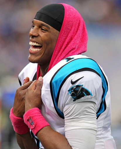 Oct 13, 2013; Minneapolis, MN, USA; Carolina Panthers quarterback Cam Newton (1) laughs during the fourth quarter against the Minnesota Vikings at Mall of America Field at H.H.H. Metrodome. The Panthers defeated the Vikings 35-10. Mandatory Credit: Brace Hemmelgarn-USA TODAY Sports