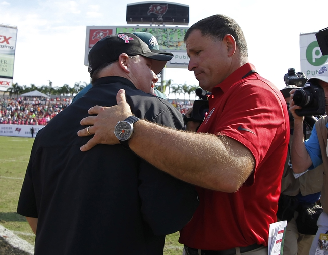 Oct 13, 2013; Tampa, FL, USA; Tampa Bay Buccaneers head coach Greg Schiano and Philadelphia Eagles head coach Chip Kelly greet at the end of the game during the second half at Raymond James Stadium. Philadelphia Eagles defeated the Tampa Bay Buccaneers 31-20. Mandatory Credit: Kim Klement-USA TODAY Sports