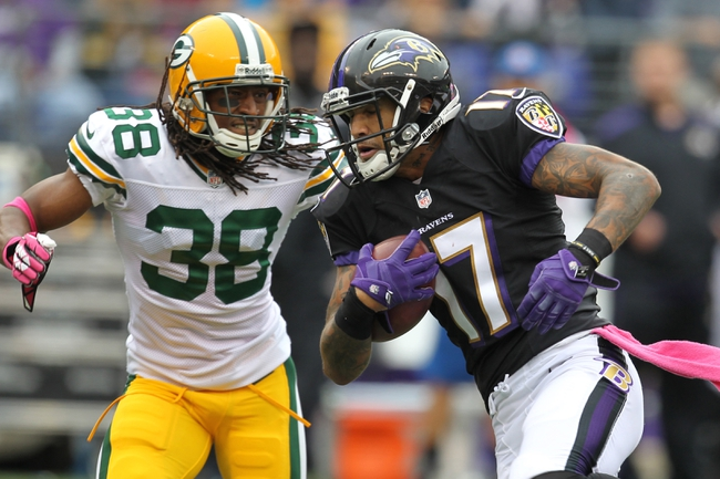 Oct 13, 2013; Baltimore, MD, USA; Baltimore Ravens wide receiver Tandon Doss (17) is tackled following a long catch and fourth quarter gain by Green Bay Packers cornerback Tramon Williams (38) at M&T Bank Stadium. Mandatory Credit: Mitch Stringer-USA TODAY Sports