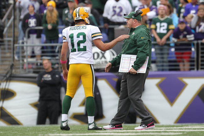 Oct 13, 2013; Baltimore, MD, USA; Green Bay Packers quarterback Aaron Rodgers (12) talks with head coach Mike McCarthy in the closing minutes of the game against the Baltimore Ravens at M&T Bank Stadium. Mandatory Credit: Mitch Stringer-USA TODAY Sports