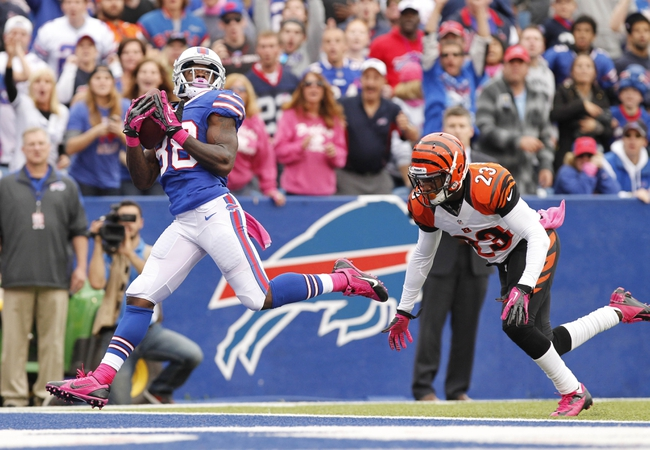 Oct 13, 2013; Orchard Park, NY, USA; Buffalo Bills wide receiver Marquise Goodwin (88) catches a touchdown to tie the game as Cincinnati Bengals cornerback Terence Newman (23) pursues during the second half at Ralph Wilson Stadium. Bengals beat the Bills 27-24. Mandatory Credit: Kevin Hoffman-USA TODAY Sports