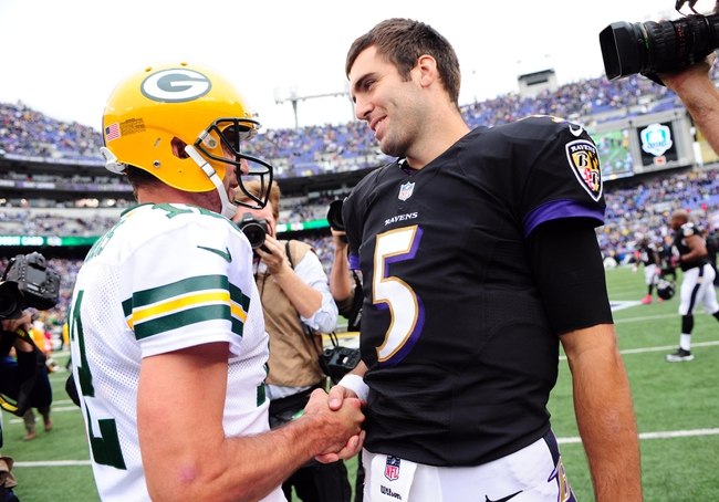 Oct 13, 2013; Baltimore, MD, USA; Green Bay Packers quarterback Aaron Rodgers (12) shakes hands with Baltimore Ravens quarterback Joe Flacco (5) after the game at M&T Bank Stadium. Mandatory Credit: Evan Habeeb-USA TODAY Sports