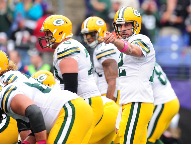 Oct 13, 2013; Baltimore, MD, USA; Green Bay Packers quarterback Aaron Rodgers (12) communicates with teammates during the fourth quarter against the Baltimore Ravens at M&T Bank Stadium. Mandatory Credit: Evan Habeeb-USA TODAY Sports