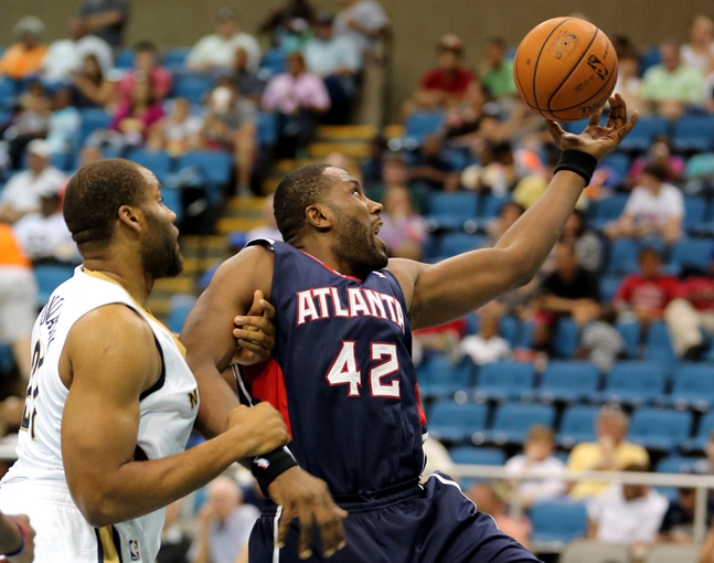 Oct 13, 2013; Biloxi, MS, USA; Atlanta Hawks power forward Elton Brand (42) is fouled by New Orleans Pelicans power forward Arinze Onuaku (21) during the second half of their game at the Mississippi Coast Coliseum. The Pelicans won 105-73. Mandatory Credit: Chuck Cook-USA TODAY Sports