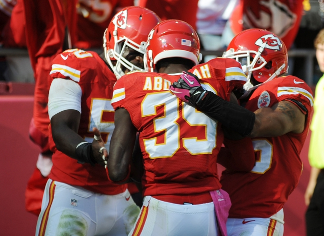 Oct 13, 2013; Kansas City, MO, USA; Kansas City Chiefs defensive back Husain Abdullah (39) is congratulated by outside linebacker Justin Houston (50) and defensive back Quintin Demps (35) after Abdullah scores during the second half of the game against the Oakland Raiders at Arrowhead Stadium. The Chiefs won 24-7. Mandatory Credit: Denny Medley-USA TODAY Sports