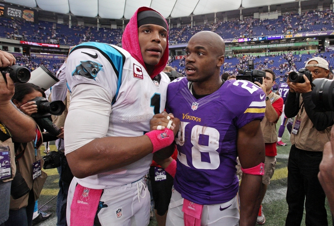 Oct 13, 2013; Minneapolis, MN, USA; Minnesota Vikings running back Adrian Peterson (28) talks with Carolina Panthers quarterback Cam Newton (1) following the game at Mall of America Field at H.H.H. Metrodome. The Panthers defeated the Vikings 35-10. Mandatory Credit: Brace Hemmelgarn-USA TODAY Sports