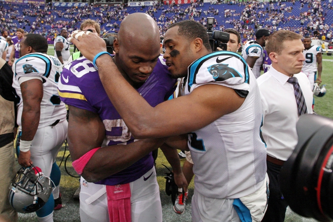 Oct 13, 2013; Minneapolis, MN, USA; Minnesota Vikings running back Adrian Peterson (28) is hugged by Carolina Panthers safety Mike Mitchell (21) following the game at Mall of America Field at H.H.H. Metrodome. The Panthers defeated the Vikings 35-10. Mandatory Credit: Brace Hemmelgarn-USA TODAY Sports
