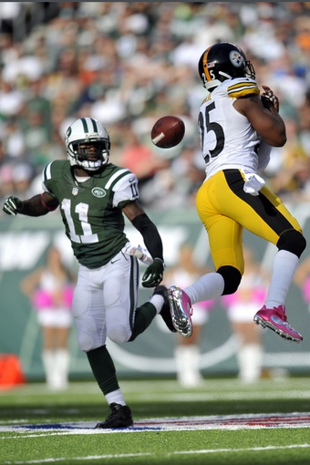 Oct 13, 2013; East Rutherford, NJ, USA; Pittsburgh Steelers free safety Ryan Clark (25) breaks up a pass to New York Jets wide receiver Jeremy Kerley (11) during the second half at MetLife Stadium. The Steelers won the game 19-6. Mandatory Credit: Joe Camporeale-USA TODAY Sports