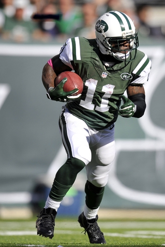 Oct 13, 2013; East Rutherford, NJ, USA; New York Jets wide receiver Jeremy Kerley (11) returns a punt against the Pittsburgh Steelers during the second half at MetLife Stadium. The Steelers won the game 19-6. Mandatory Credit: Joe Camporeale-USA TODAY Sports