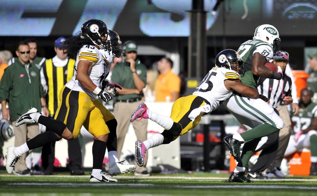 Oct 13, 2013; East Rutherford, NJ, USA; Pittsburgh Steelers free safety Ryan Clark (25) tackles New York Jets tight end Jeff Cumberland (87) after a reception during the second half at MetLife Stadium. The Steelers won the game 19-6. Mandatory Credit: Joe Camporeale-USA TODAY Sports