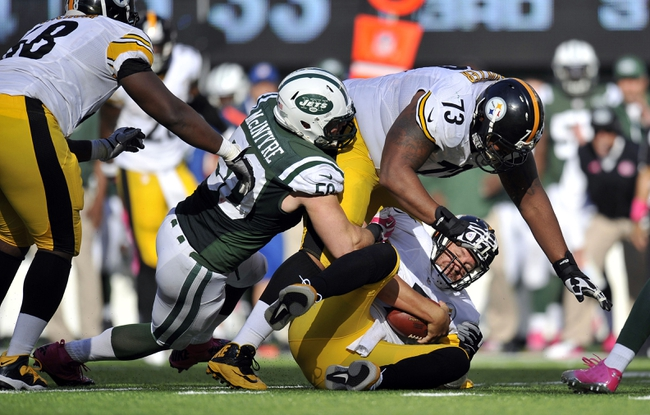 Oct 13, 2013; East Rutherford, NJ, USA; New York Jets defensive end Muhammad Wilkerson (96) sacks Pittsburgh Steelers quarterback Ben Roethlisberger (7) during the second half at MetLife Stadium. The Steelers won the game 19-6. Mandatory Credit: Joe Camporeale-USA TODAY Sports